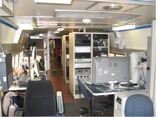 The inside of an Amtrak train, including computers.