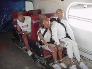 Crash dummies in a train car.